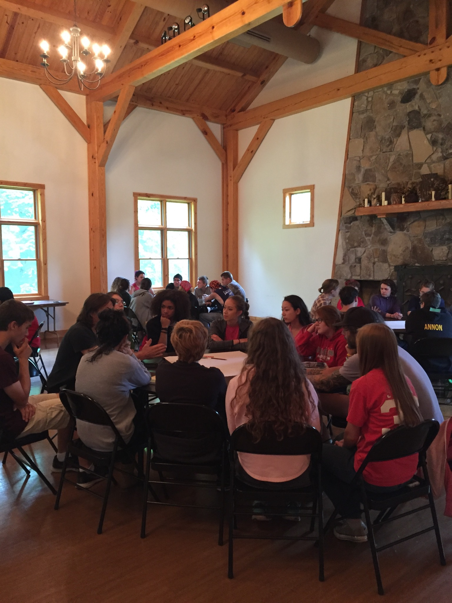 Teen week students participate in round table discussions.